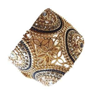 Gold tone cuff statement bracelet Filligree